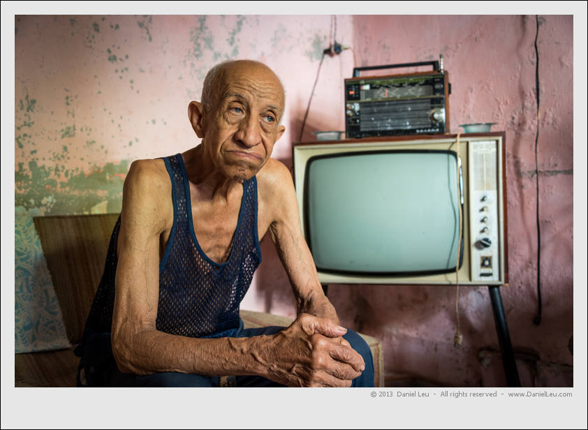 The old man at home with TV