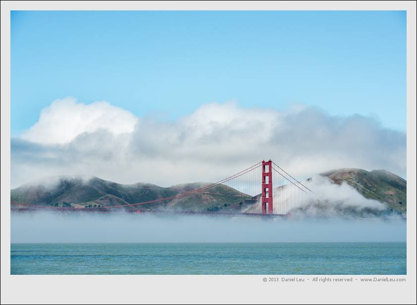 Golden Gate Bridge rising above fog