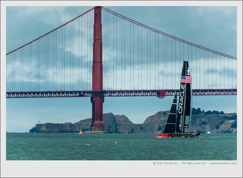 Oracle' AC72 in front of Golden Gate Bridge