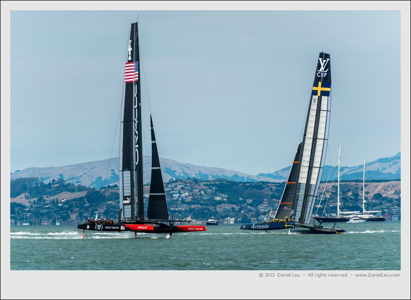 Oracle's AC72 crossing Artemis Racing's Big Blue