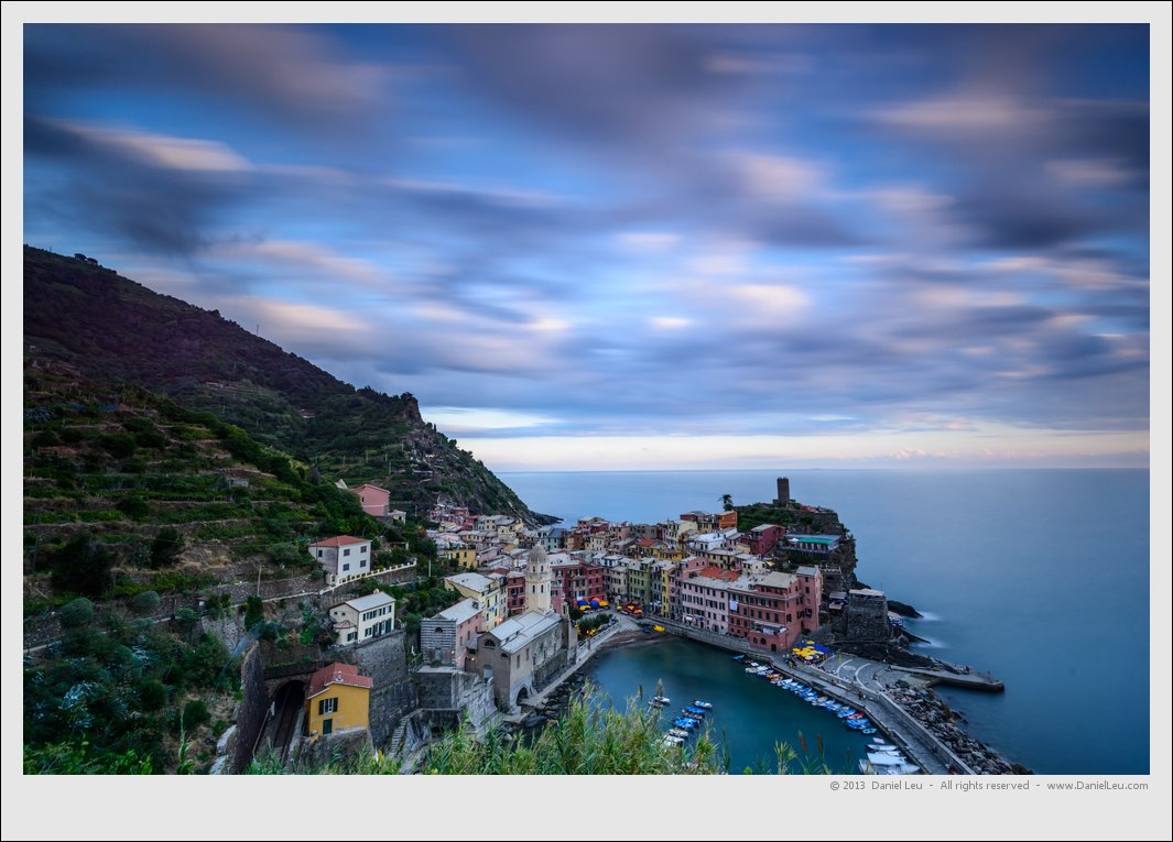 Vernazza at dusk with a cloudy sky