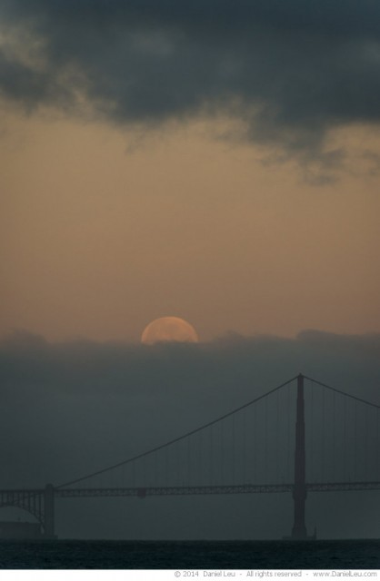 Full Moon behind Fog Layer and Golden Gate Bridge