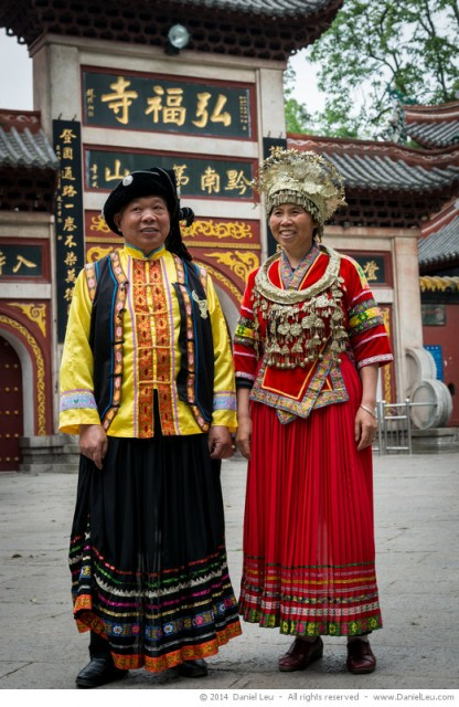 Couple in traditional dresses in front of the Hongfu Temple