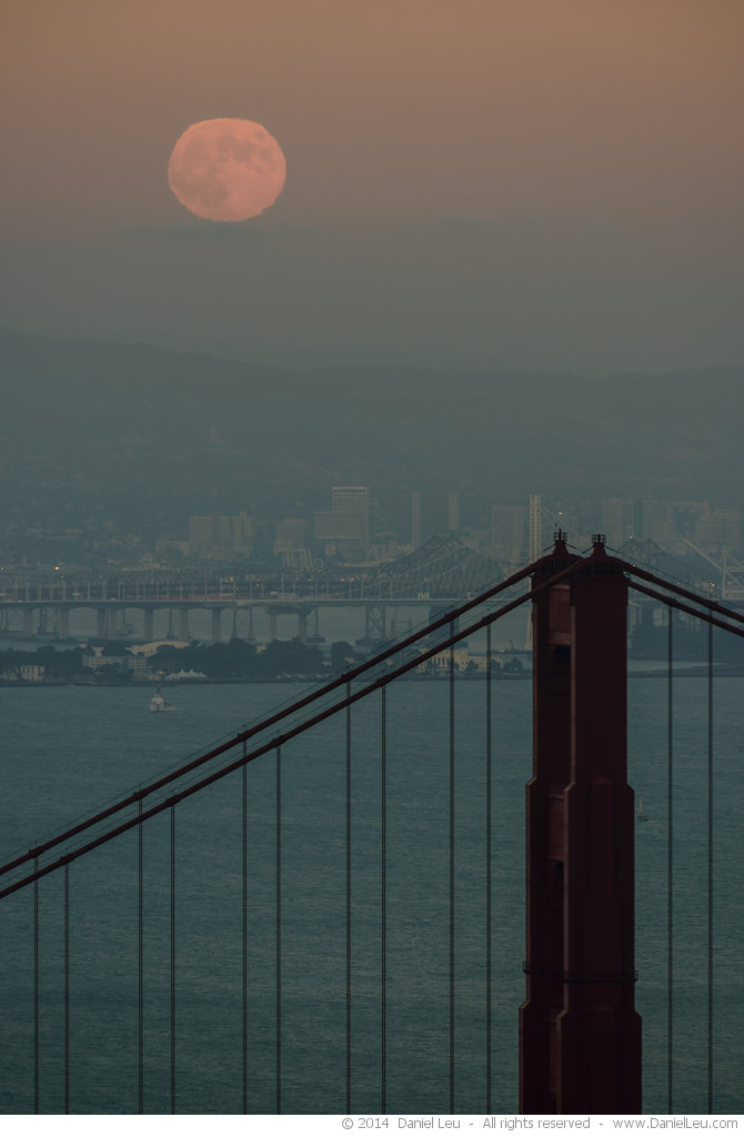 Super Harvest Moon rising over Golden Gate Bridge Tower