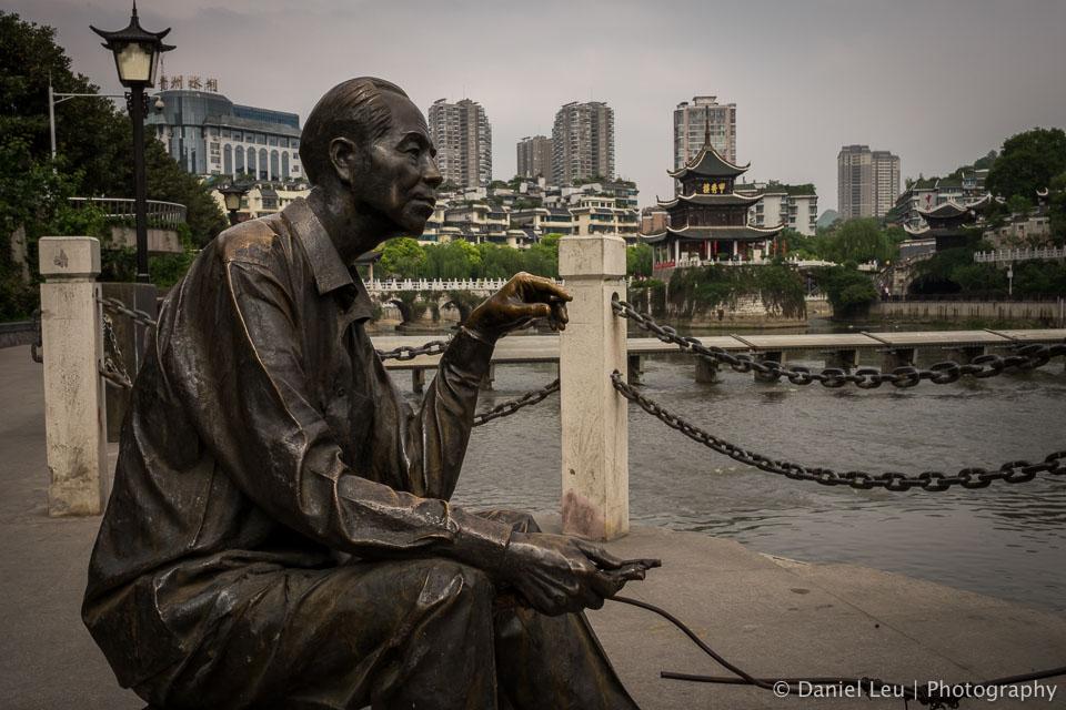 Fisherman Statue with Jiaxiu Tower