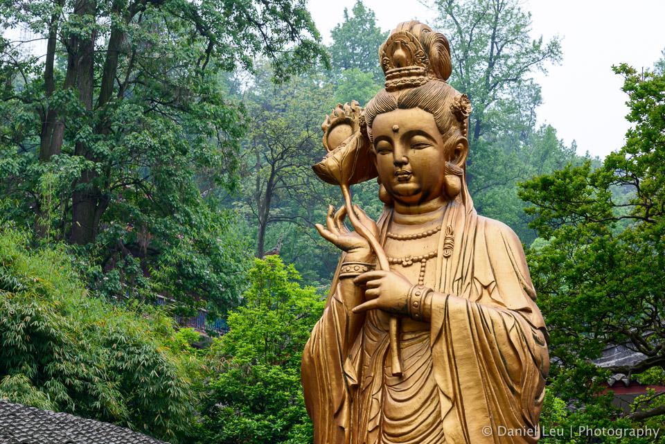 Reflection of Guan Yin statue in Hongfu Temple