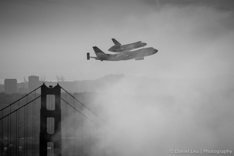 Space shuttle endeavour on top of the Shuttle Carrier Aircraft (SCA) over San Francisco on its way to retirmenet.