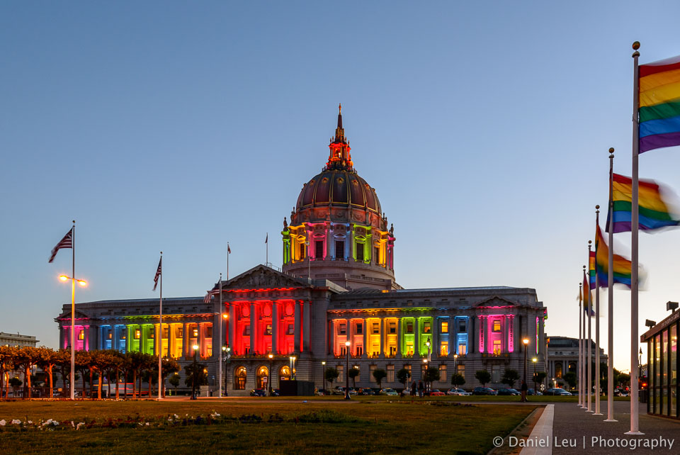 Rainbow flags and rainbow colored City Hall