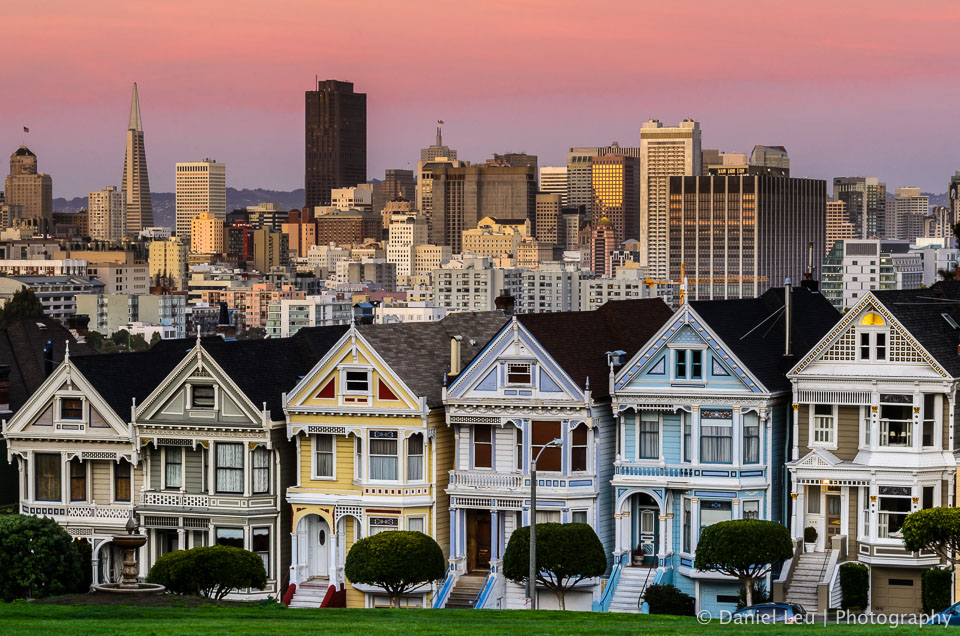 One of so many iconic postcard scenes in San Francisco: the view from Alamo Square with the colorful Victorians in the foreground and the skyscrapers of the financial district in the background.
