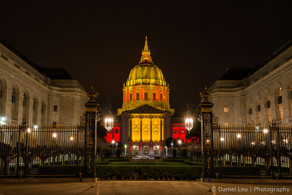 San Francisco's city hall in red and gold celebrating the 49ers post season run.